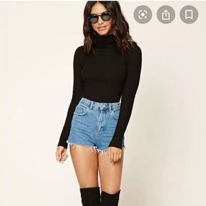 Black turtleneck long sleeve ribbed shirt